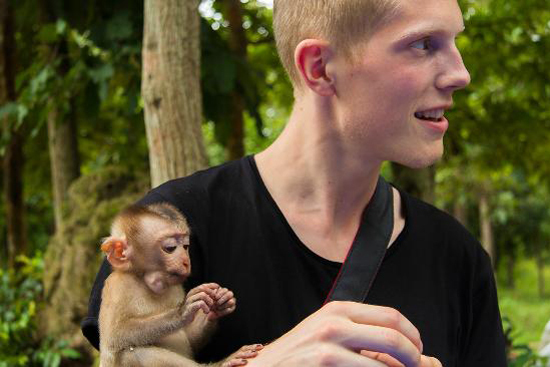 Travelers with a cute small monkey at Phnom Tamao Wildlife Rescue Center