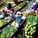 Fruit sellers along the canal of Damnoen Saduak Floating Market