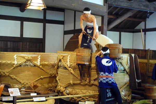 ef3d896d0fa Two men performing sake-making steps in Hakutsuru Sake Brewery