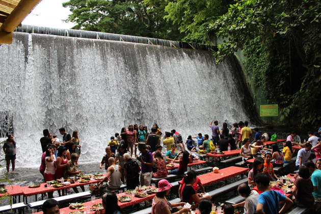 People having sumptuous buffet lunch at the Villa Escudero waterfall