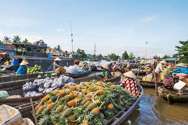 Boats full of fruit and vegetable in Floating Market, Mekong Delta